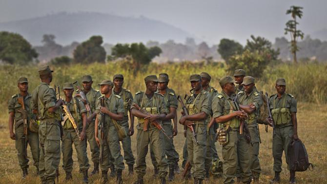 Soldiers from the Republic of Congo, operating under a multinational central-african regional mandate, stand in formation after arriving by airplane to boost existing forces, at an airport in Bangui, Central African Republic Monday, Dec. 31, 2012. Rebels in the Central African Republic on Monday rejected appeals for them to halt their advances and to negotiate to form a coalition government. (AP Photo/Ben Curtis)