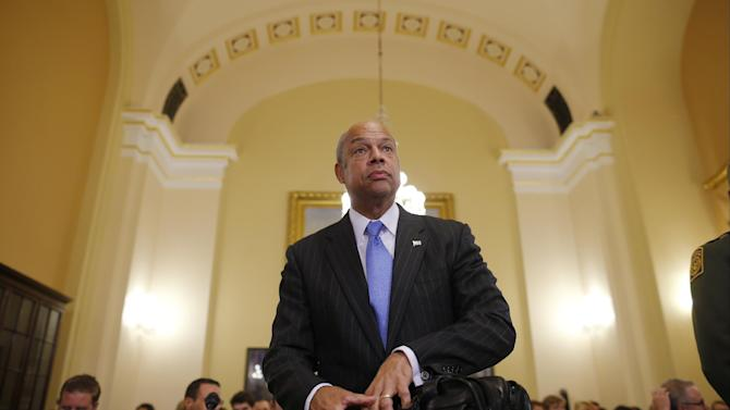 "FILE - This June 24, 2014, file photo shows Homeland Security Secretary Jeh Johnson arriving to testify before the House Committee on Homeland Security on Capitol Hill in Washington about the growing problem of unaccompanied children crossing the border into the United States. On NBC's ""Meet the Press"", Sunday, July 6, 2014, Johnson said that all persons regardless of age face ""a deportation proceeding"" if they enter the country illegally. The Obama administration, he said, is ""looking at ways to create additional options for dealing with the children in particular, consistent with our laws and our values."" (AP Photo/Charles Dharapak, File)"