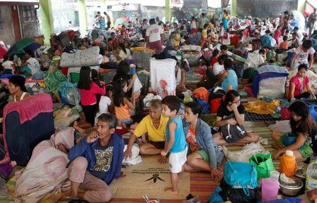 Residents take shelter at an evacuation centre for flood victims a day after tropical storm Fung-Wong inundated the Philippine capital Manila