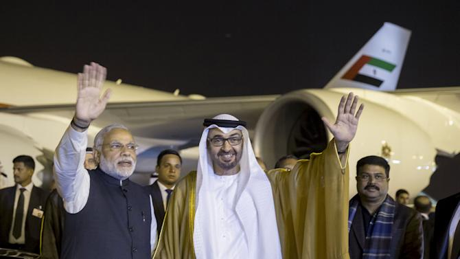 Abu Dhabi Crown Prince Mohammed bin Zayed Al Nahyan and India's Prime Minister Narendra Modi wave upon Al Nahyan's arrival in New Delhi