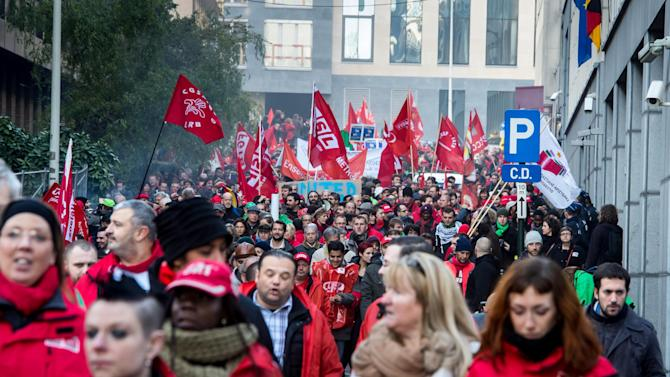 European trade unionists protest in Brussels on Wednesday, Nov. 14, 2012. With rampant unemployment spreading misery in southern Europe and companies shutting factories across the continent, workers around the European Union sought to unite in a string of strikes and demonstrations on Wednesday. (AP Photo/Geert Vanden Wijngaert)