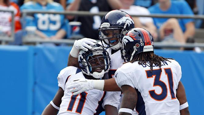 Denver Broncos' Trindon Holliday (11) celebrates with teammates, including Omar Bolden (31), after returning a Carolina Panthers punt for a touchdown during the first half of an NFL football game in Charlotte, N.C., Sunday, Nov. 11, 2012. (AP Photo/Bob Leverone)