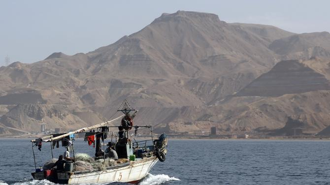 Fishermen ride a boat at El Ain El Sokhna during a tourism promotional state program, in Suez Governorate