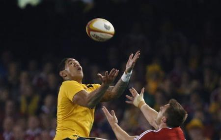 Australia Wallabies' Tomane and British and Irish Lions' Bowe battles for control of a high ball during their rugby union test match in Melbourne
