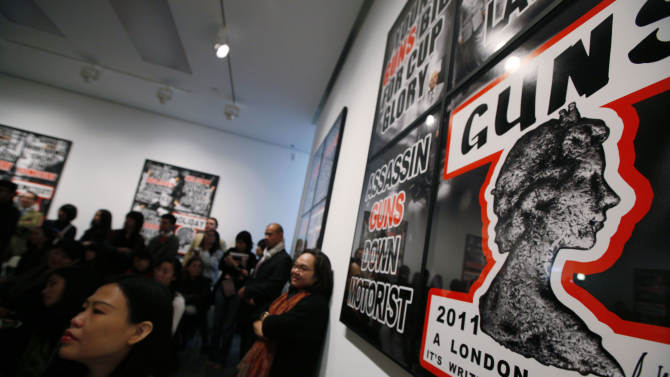 FILE - In this March 1, 2012 file photo, visitors attend the press conference of British artists Gilbert & George in the White Cube gallery in Hong Kong. In the past decade, Hong Kong's art scene has mushroomed thanks to soaring numbers of wealthy mainland Chinese and other Asians who have developed a taste for collecting. Big names like London's White Cube and Larry Gagosian of the U.S. have opened local outposts of their art dealing empires while numerous lesser-known galleries have also sprouted up over the past decade. (AP Photo/Kin Cheung, FILE)