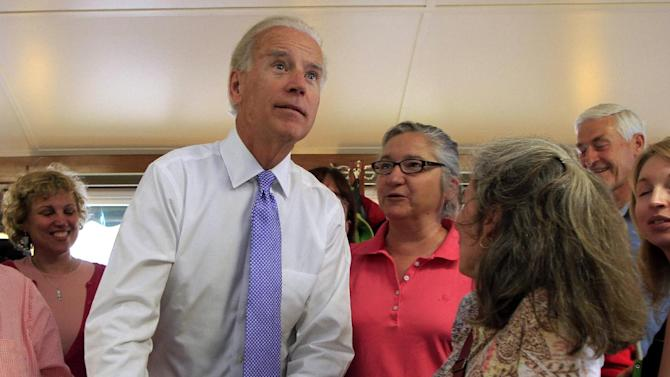 Vice President Joe Biden looks up at the menu during a campaign lunch stop at a diner in Peterborough, N.H., Tuesday, May 22, 2012.  (AP Photo/Jim Cole)