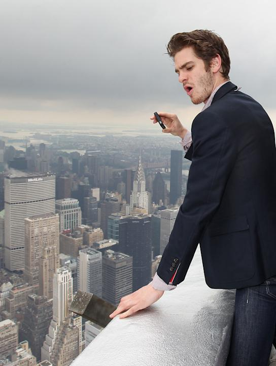 Celebrity photos: During his promotional trail for the new Spiderman movie, Andrew Garfield made a trip to the top of the Empire State building. He was so overwhelmed by the view that he whipped out h