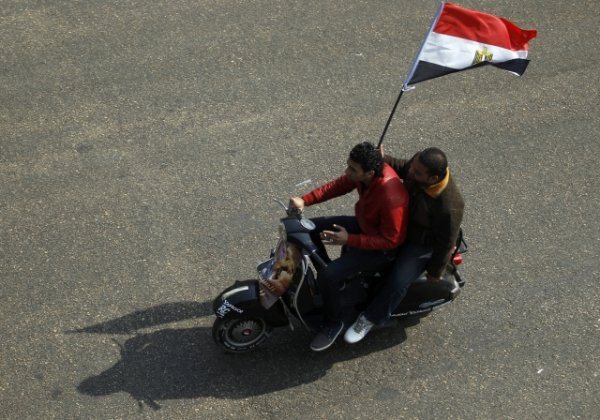 2014-01-25T130132Z_1032063545_GM1EA1P1MAH01_RTRMADP_2_EGYPT-PROTESTS