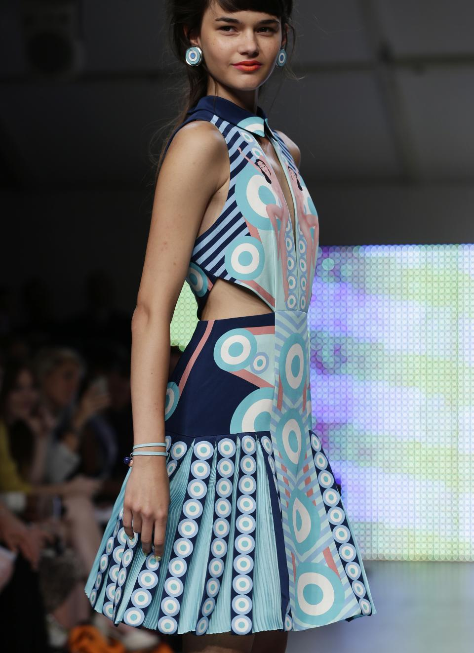 A model presents a creation by Holly Fulton during her Spring/Summer 2013 show at London Fashion Week in London, Saturday, Sept. 15, 2012. (AP Photo/Alastair Grant)
