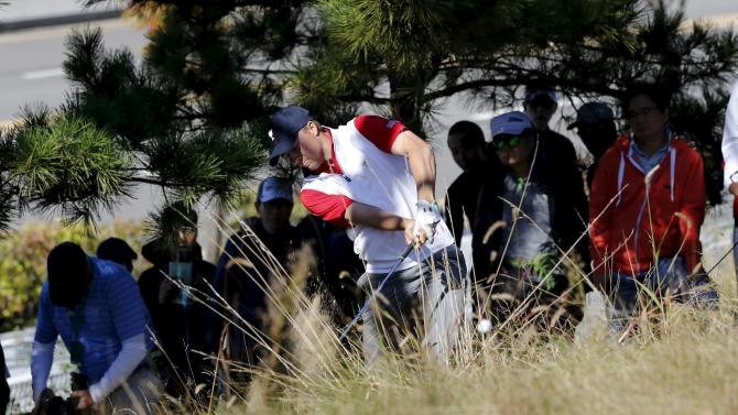 U.S. team member Spieth hits the ball from the rough on the second hole during the four ball matches of the 2015 Presidents Cup golf tournament in Incheon, South Korea