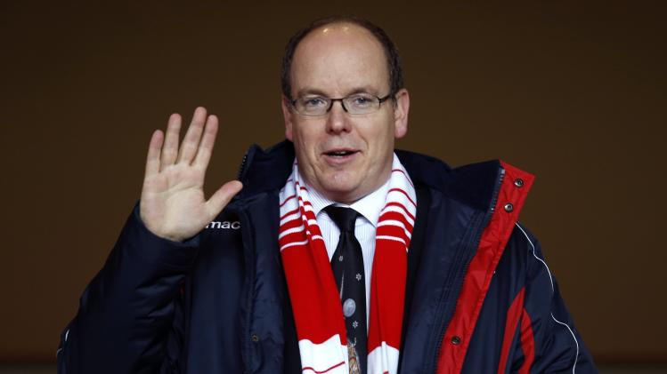 Prince Albert II of Monaco waves as he arrives to attend the French Ligue 1 soccer match between Monaco and Valenciennes at Louis II stadium
