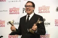 "Director David O. Russell poses with his awards for best director and best screenplay for ""Silver Linings Playbook"" at the 2013 Film Independent Spirit Awards in Santa Monica, California February 23, 2013. REUTERS/Phil McCarten"