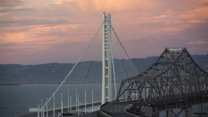 The new eastern span of the San Francisco-Oakland Bay bridge stands next to the old bridge in San Francisco, California