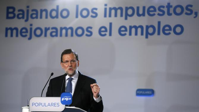 Spain's Prime Minister Mariano Rajoy gestures during a People's Party (Partido Popular) political event in Barcelona