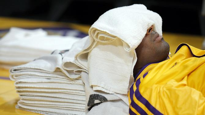 Los Angeles Lakers' Kobe Bryant rests before an NBA basketball game against the Indiana Pacers in Los Angeles, Tuesday, Nov. 27, 2012. (AP Photo/Jae C. Hong)