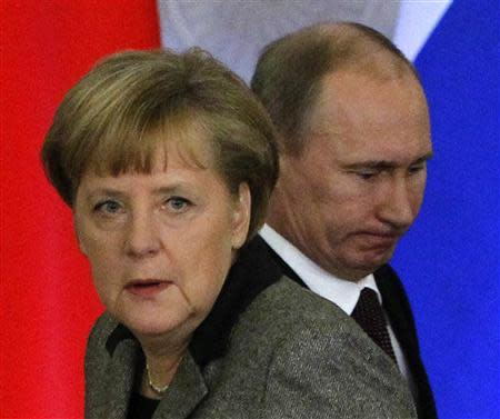 File photo of Russian President Putin and German Chancellor Merkel arriving for a joint news conference in Kremlin
