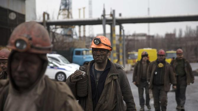 Miners walk out of the Zasyadko coal mine in Donetsk