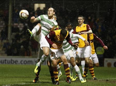 Celtic's Stokes challenges Motherwell's Hutchinson during their Scottish Premier League soccer match at Fir Park Stadium, Motherwell