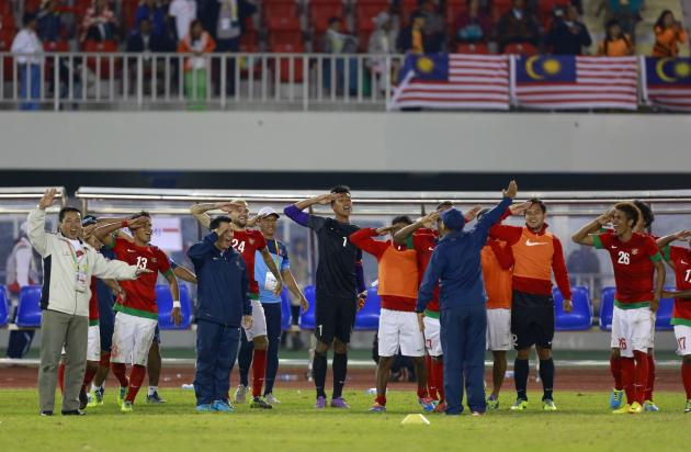 Indonesia's soccer team celebrates after defeating Malaysia during soccer semi-final at the 27th SEA Games in Naypyitaw