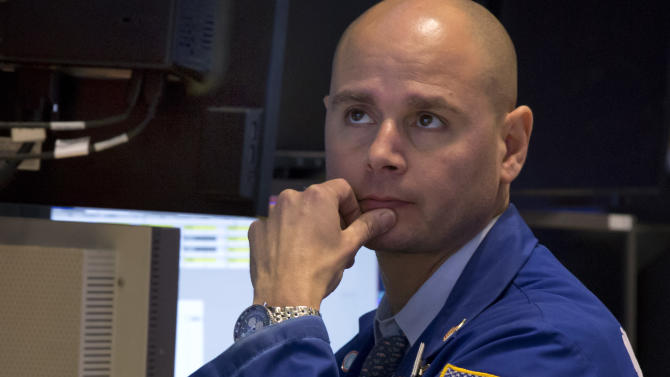 Specialist Mario Picone works on the floor of the New York Stock Exchange, Thursday, June 20, 2013. Financial markets are sliding after the Federal Reserve said it could end its huge bond-buying program by the middle of next year. (AP Photo/Richard Drew)