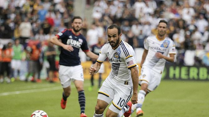 FILE- In this Dec. 7, 2014, file photo, Los Angeles Galaxy's Landon Donovan chases the ball during the second half of the MLS Cup championship soccer match against the New England Revolution in Carson, Calif. Donovan will make his coaching debut in the Chipotle MLS Homegrown Game on Tuesday, July 28, 2015, in Commerce City, Colorado, part of All-Star Week. (AP Photo/Jae C. Hong, File)