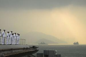 File handout picture of sailors aboard the aircraft carrier USS George Washington manning the rails as the ship pulls out of Hong Kong