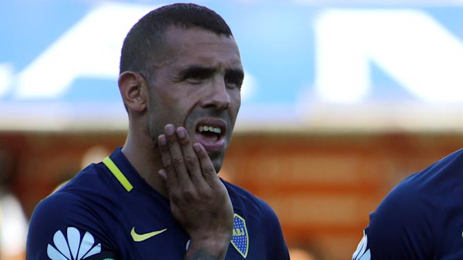 Boca Juniors' Tevez gestures as he wears an arm band with the shield of Brazilian soccer team Chapecoense before a match to pay tribute to the victims of the plane crash in Colombia in Buenos Aires