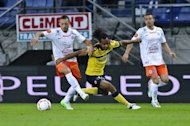 Montpellier&#39;s midfielder Jamel Saihi (L) clashes with Sochaux&#39; forward Roy Contout (C) during their French L1 football match at the August Bonal Stadium in Montbeliard. Montpellier registered their first win as they downed Sochaux 3-1