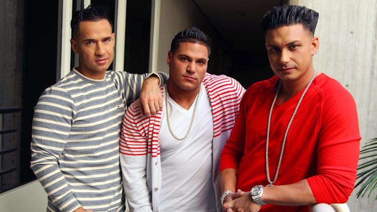 """This Oct. 2, 2012 photo shows cast members, from left, Mike """"The Situation"""" Sorrentino, Ronnie Ortiz-Magro and Paul """"Pauly D"""" DelVecchio from the television show """"Jersey Shore"""", pose for a portrait in Los Angeles. The final season of the MTV reality season premieres on Thursday. (Photo by Matt Sayles/Invision/AP)"""