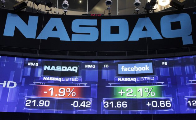 Pre-market prices for Nasdaq stock, left, and Facebook stock are shown, Wednesday, May 23, 2012 at the Nasdaq MarketSite in New York. Facebook stock rose in early trading Wednesday, although still far below the $38 it was priced at before its initial public offering Friday. (AP Photo/Mark Lennihan)