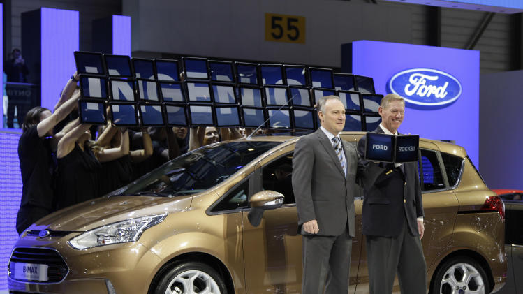 Stephen Odell, left, CEO of Ford Europe, and Alan Mullaly President and CEO of Ford Motor Company introduce the Ford B-Max on Tuesday, March 6, 2012 during the press preview days at the 82nd Geneva International Motor Show in Geneva, Switzerland. The Motor Show will open it's doors to the public from March 8 to 18, presenting more than 260 exhibitors and more than 180 world and European premieres. (AP Photo/Frank Augstein)