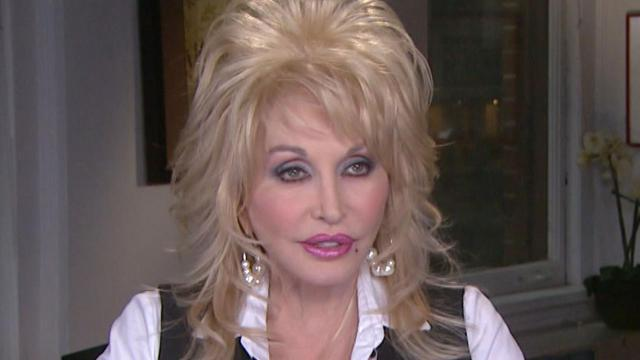 EXCLUSIVE: Dolly Parton Opens Up About Poor Upbringing & Why She Wouldn't Trade It for Anything