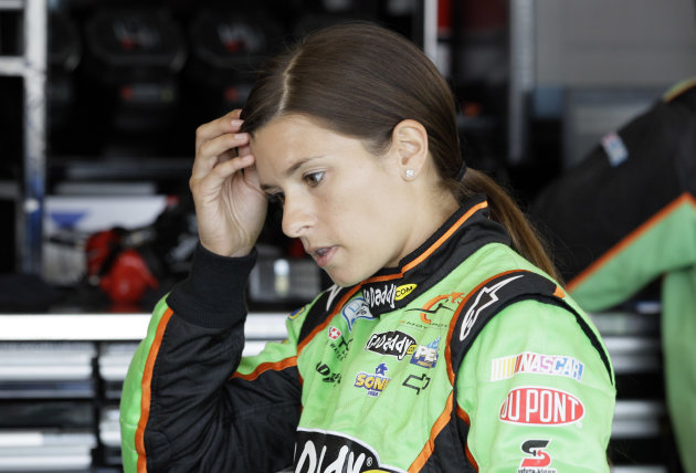 Danica Patrick checks her hair during practice for Sunday&#39;s NASCAR Nationwide Series auto race at Chicagoland Speedway in Joliet, Ill., Saturday, July 21, 2012. (AP Photo/Nam Y. Huh)