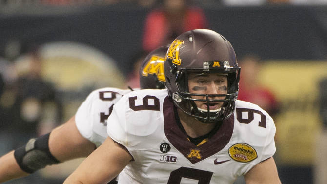 Minnesota quarterback Philip Nelson scrambles during the first quarter against Texas Tech in the Meineke Car Care Bowl NCAA college football game, Friday, Dec. 28, 2012, in Houston. (AP Photo/Dave Einsel)