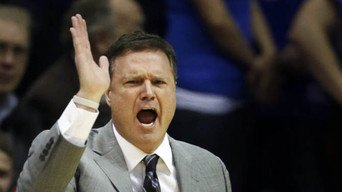 Kansas head coach Bill Self directs his team during the first half of an NCAA college basketball game against Richmond in Lawrence, Kan., Tuesday, Dec. 18, 2012. (AP Photo/Orlin Wagner)