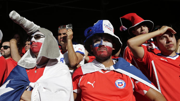 Chile soccer fans look out from the stands after their team lost to Brazil in a penalty shootout at a World Cup round of 16 match in Mineirao Stadium in Belo Horizonte, Brazil, Saturday, June 28, 2014. Brazil won the match 3-2 on penalties after the match ended 1-1. (AP Photo/Petr David Josek)