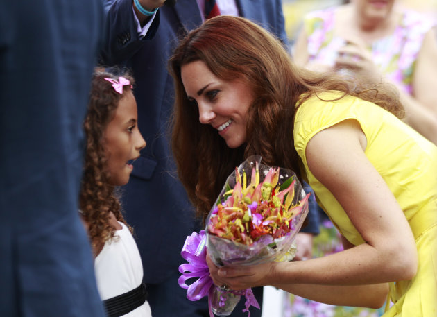 Britain&#39;s Kate, the Duchess of Cambridge, talks to a girl during the opening ceremony of the renovated Commonwealth Street in central Honiara, Solomon Islands, Monday, Sept. 17, 2012. Prince William, the Duke of Cambridge, and his wife Kate are on their third stop of a nine-day tour of Southeast Asia and the South Pacific on behalf of Queen Elizabeth II to commemorate her Diamond Jubilee. (AP Photo/Daniel Munoz, Pool)