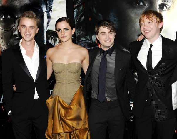 "FILE - In this July 11, 2011 file photo, cast members, from left, Tom Felton, Emma Watson, Daniel Radcliffe and Rupert Grint pose together at the premiere of ""Harry Potter and the Deathly Hallows: Part 2"" at Avery Fisher Hall in New York. The film is the eighth and final film in the Harry Potter series. (AP Photo/Evan Agostini, file)"