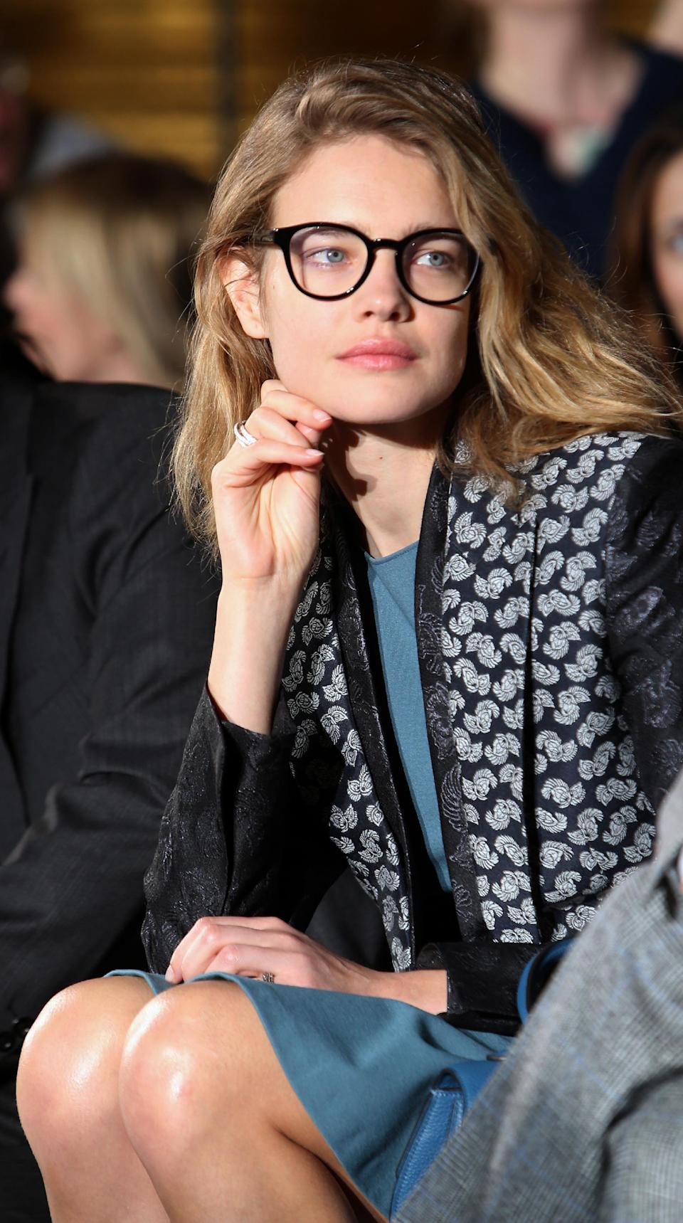 Natalia Vodianova watches fashion designer Stella McCartney's Fall/Winter 2013-2014 ready to wear collection, in Paris, Monday, March, 4, 2013. (AP Photo/Thibault Camus)