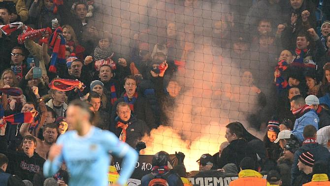 CSKA Moscow fans let off a flare during a match in Manchester, England on November 5, 2013