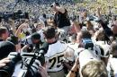 FILE - In this Sept. 1, 2007, file photo, Appalachian State coach Jerry Moore is carried off the field at Michigan Stadium by his players after they upset No. 5 Michigan 34-32 in an NCAA college football game in Ann Arbor, Mich. Michigan is opening its 2014 season with Appalachian State this week, rekindling flashbacks to the day the Wolverines were on the wrong end of one of the biggest upsets in college football history. (AP Photo/Duane Burleson, File)