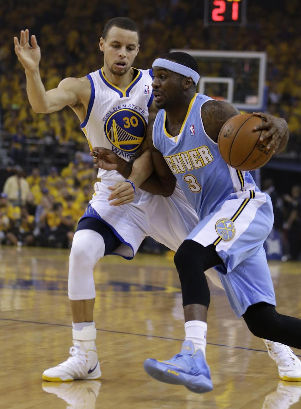 Denver Nuggets' Ty Lawson, right, drives the ball past Golden State Warriors' Stephen Curry (30) during the first half of Game 4 in a first-round NBA basketball playoff series on Sunday, April 28, 2013, in Oakland, Calif. (AP Photo/Ben Margot)