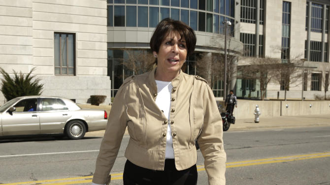 Former Arkansas Treasurer Martha Shoffner walks from the federal courthouse in Little Rock, Ark., during a break Monday, March 10, 2014. Shoffner faces 14 bribery and extortion counts and has pleaded not guilty. She resigned last year. (AP Photo/Danny Johnston)
