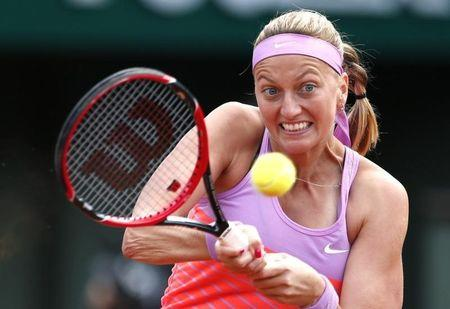 Petra Kvitova of the Czech Republic plays a shot to Irina-Camelia Begu of Romania during their women's singles match at the French Open tennis tournament at the Roland Garros stadium in Paris