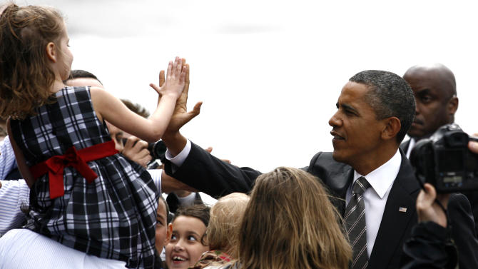 President Barack Obama greets supporters after disembarking Air Force One at Boeing Field Sunday, Sept. 25, 2011, in Seattle. (AP Photo/Joe Nicholson)