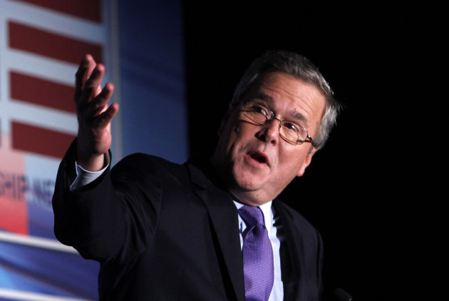 "FILE - This Jan. 26, 2012 file photo shows former Florida Gov. Jeb Bush speaking in Miami. Bush is reiterating that he won't join Mitt Romney on the GOP presidential ticket. Bush says no one's asked him to submit personal documents to the team picking Romney's vice presidential nominee. He also says he's certain he won't be asked, either. Bush says he backs his ""friend"" and fellow Floridian, Sen. Marco Rubio. (AP Photo/Wilfredo Lee, File)"