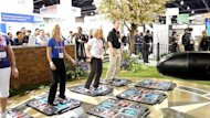 The 2013 Consumer Electronics Show includes a zone on fitness and health, pictured on January 9, 2012, with a variety of gadgets and services, including a heart monitoring app from Polar, a helmet cam for skiers from Geonaute, Fitbug's fitness monitor, and a game to help encourage exercise developed by United HealthCare
