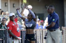 Sanya Richards-Ross waves to the crowd after after pulling up 250 meters into her lap around the track during qualifying for women's 400-meter run at the U.S. Olympic Track and Field Trials, Friday, July 1, 2016, in Eugene Ore. (AP Photo/Marcio Jose Sanchez)