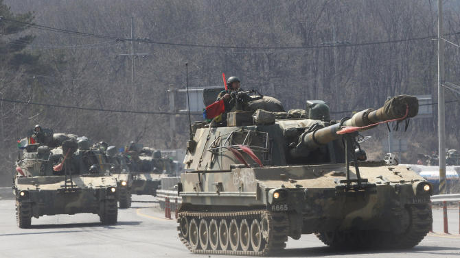 South Korean army K-55 self-propelled howitzers move during an exercise against possible attacks by North Korea in Pocheon, South Korea, near the border with North Korea, Wednesday, March 27, 2013. North Korea said Wednesday that it had cut off a key military hotline with South Korea that allows cross border travel to a jointly run industrial complex in the North, a move that ratchets up already high tension and possibly jeopardizes the last major symbol of inter-Korean cooperation. (AP Photo/Ahn Young-joon)