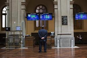 A trader looks at electronic boards at Madrid's stock exchange